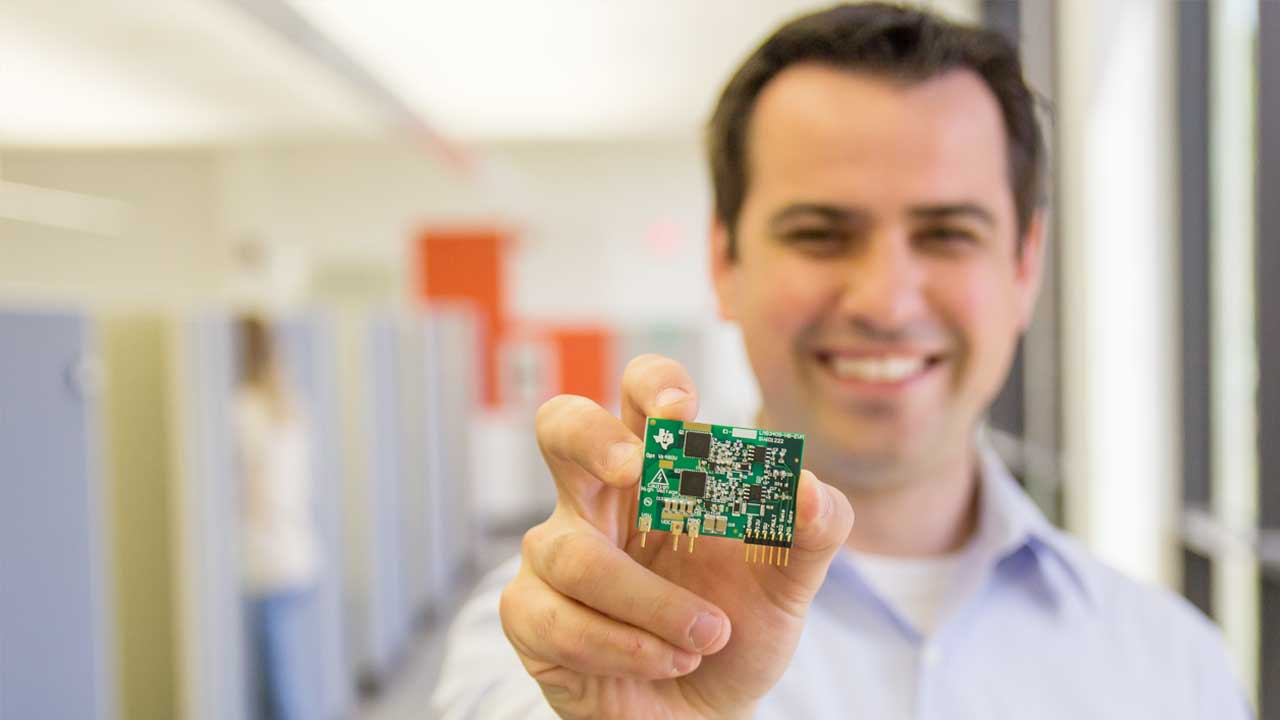man holding texas instruments board