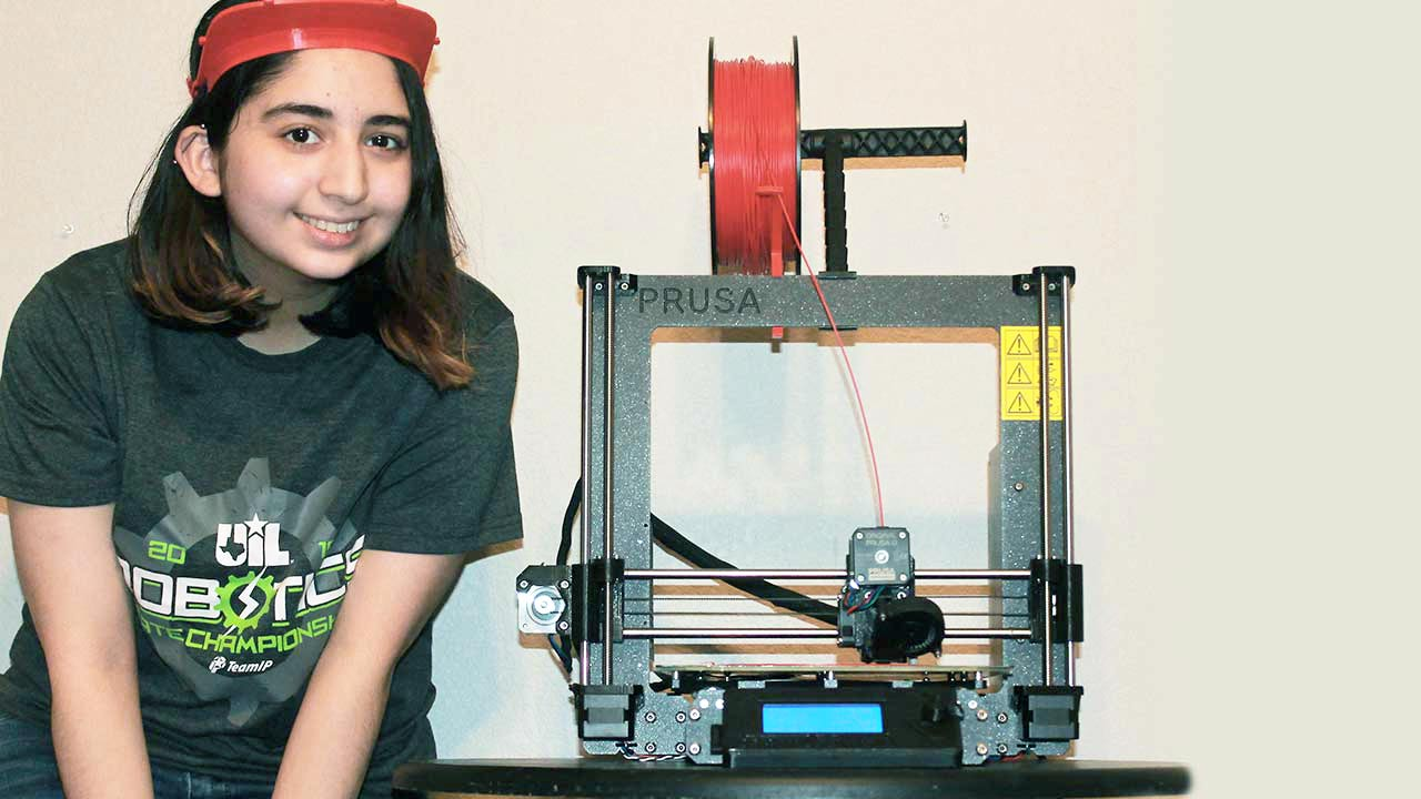 girl posing with 3D printer