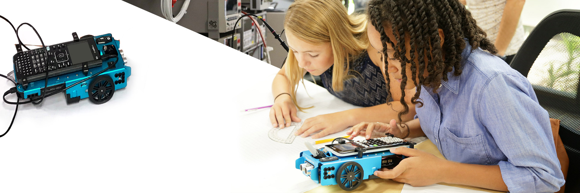 two students with TI rover