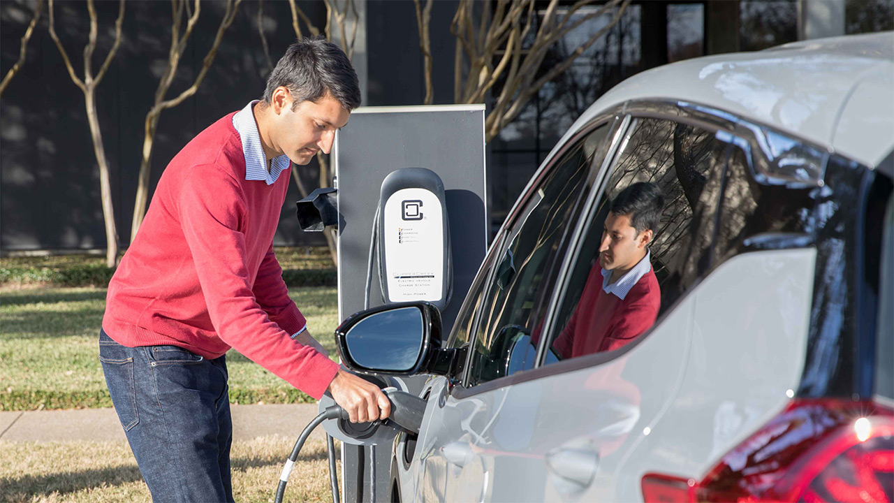Pradeep Shenoy charges his electric vehicle