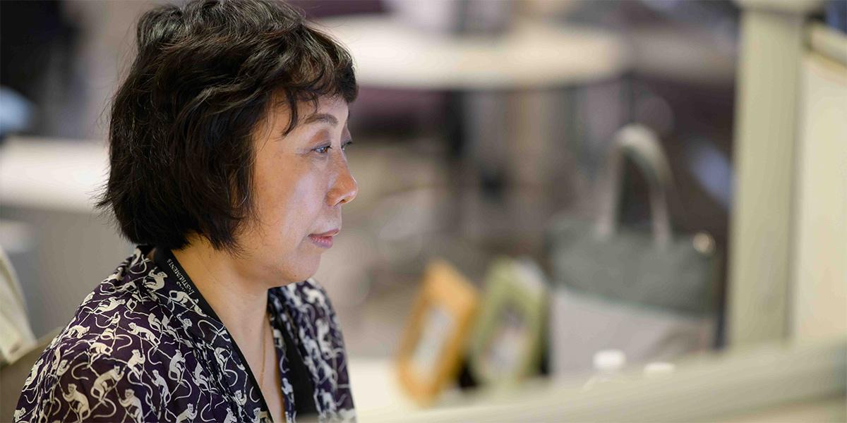 Xiaolin Lu at her desk